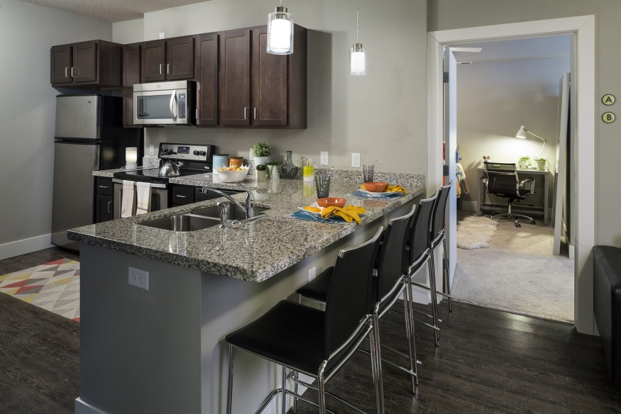 Residents of Fountain Residential's Metro Park East in Minneapolis are provided with a fully equipped kitchen. [photo: Don F. Wong]