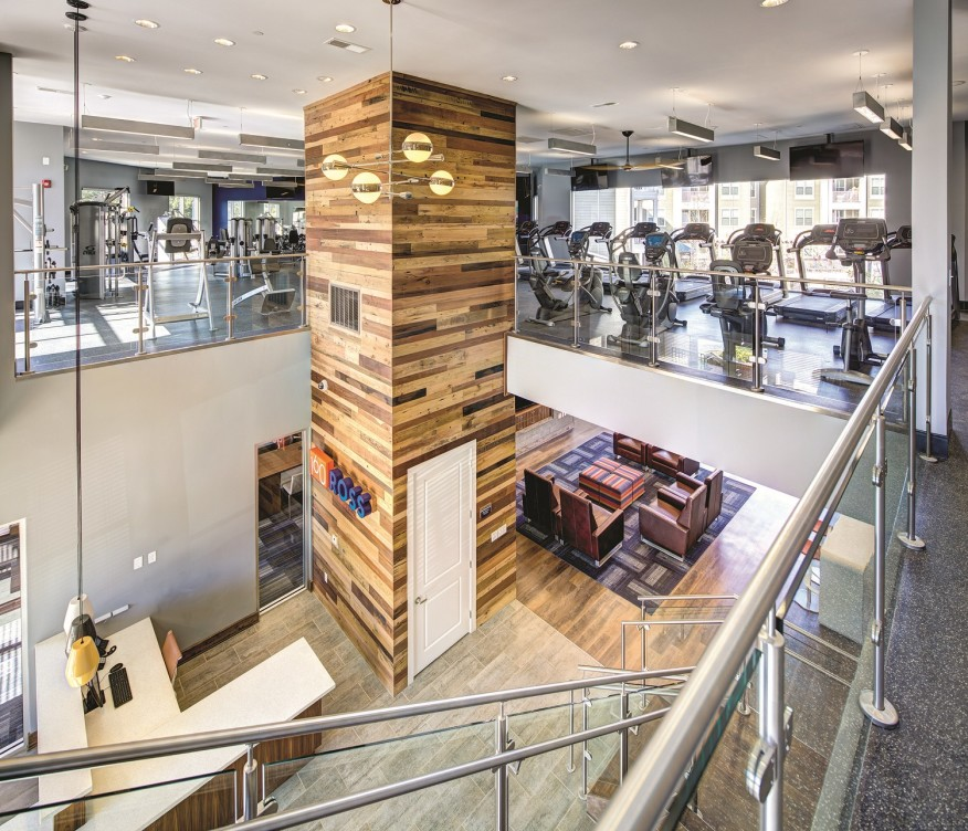 Auburn 160, an ACC property at Auburn University in Alabama, has an expansive clubhouse with lounge spaces and a full fitness center. [photo:Johnny Stevens Photography]